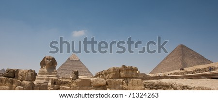 Great pyramids of Egypt with the sphinx in front. - stock photo