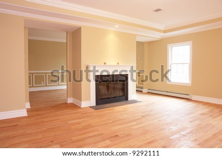 Great room with fireplace in brandnew new construction home - stock photo