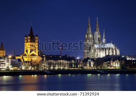 Great Saint Martin Church and Dom in Cologne at night, Germany - stock photo
