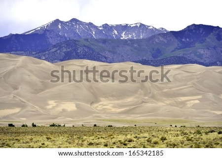 Great Sand Dunes nestled between the Rockies and the desert, southern Colorado, USA - stock photo