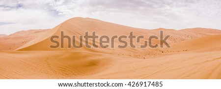 Great sand dunes of Mingsha Shan park in Dunhuang, Gansu Province, Western China. - stock photo