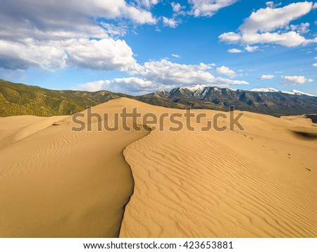 Great Sand Dunes - Top view of sand dunes on a steep ridge. - stock photo