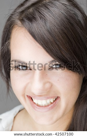 great smile of a gorgeous brunette young girl - stock photo