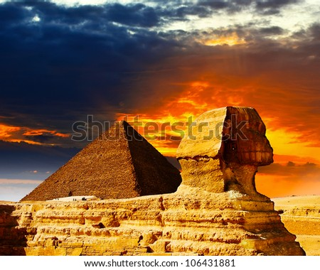 Great Sphinx and the Pyramids at sunset - stock photo