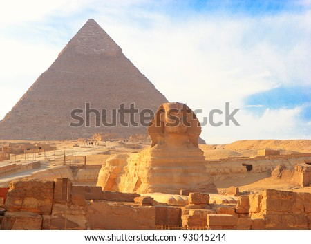 Great Sphinx of Giza against the Great Pyramid, Giza, Egypt. - stock photo