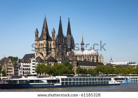 Great St Martin Church and Cologne Cathedral, big excursion ship in the forefront, Cologne, North Rhine-Westphalia, Germany - stock photo