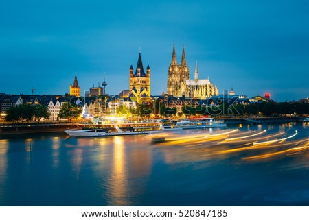 Great St. Martin Church And Dom In Cologne At Evening With Reflection In River Rhine In Cologne, Germany