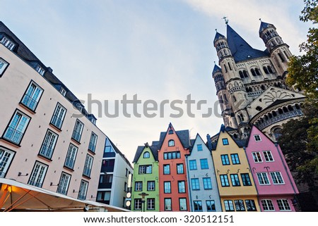 Great St. Martin Churchand and colorful houses of Cologne. Cologne, North Rhine-Westphalia, Germany.  - stock photo