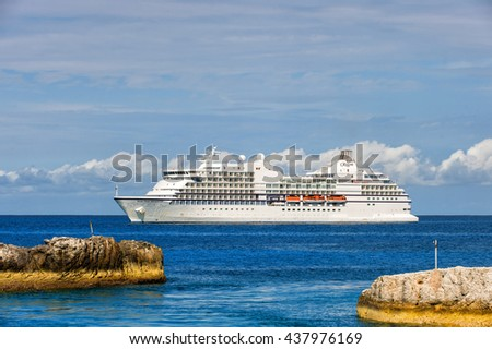 Great stirrup cay, Bahamas-January 08, 2016: Large luxury cruise ship Seven Seas Navigator anchored at sea near Great stirrup cay, Bahamas - stock photo