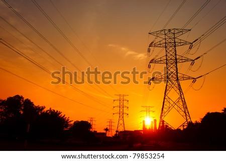 great sunset on pylon towers - stock photo