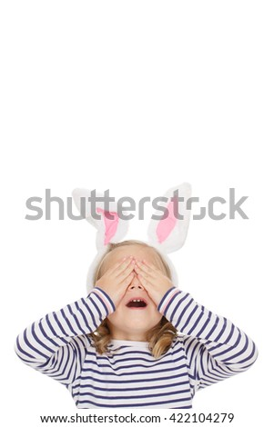Great surprise for her. Shot of a pretty little girl covering her eyes with her hands waiting for a surprise copyspace above her isolated on white. - stock photo