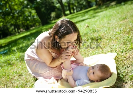 Great time - happy mother with child - stock photo