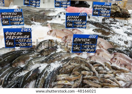 Great variety of fish on market display, tm's removed from tag - stock photo