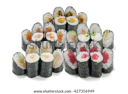 Great variety of sushi of different types. Set with salmon, mussels, shrimp, perch and cucumber. Prepared recipe of popular delicious seafood. - stock photo