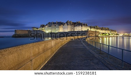 Great view at night of fortificated town Saint-Malo in Britanny - France - stock photo