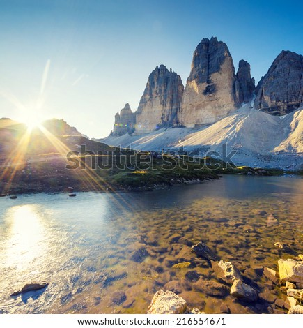 Great view of the sunny Lago Rienza - Ursprung in National Park Tre Cime di Lavaredo. Dolomites, South Tyrol. Location Auronzo, Italy, Europe. Dramatic morning scene. Beauty world.