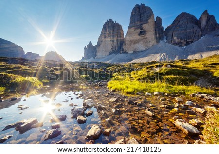 Great view of the sunny Lago Rienza - Ursprung in National Park Tre Cime di Lavaredo. Dolomites, South Tyrol. Location Auronzo, Italy, Europe. Dramatic morning scene. Beauty world. - stock photo