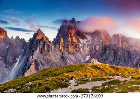 Great view of the top Cadini di Misurina range in National Park Tre Cime di Lavaredo. Dolomites, South Tyrol. Location Auronzo, Italy, Europe. Dramatic unusual scene. Beauty world. - stock photo