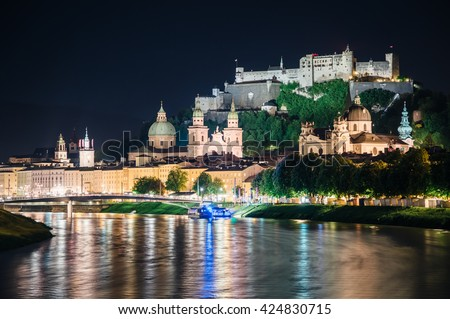 Great view on an evening city shining in the lights. Dramatic picture, picturesque scene. Location famous place (unesco heritage) Festung Hohensalzburg, Salzburger Land, Austria, Europe. Beauty world - stock photo