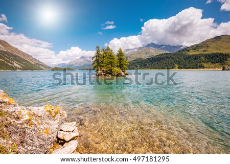 Great view on azure lake Silsersee (Sils) and peak Piz Corvatsch. Picturesque and gorgeous scene. Popular tourist attraction. Location place Upper Engadine valley, Swiss alps, Europe. Beauty world.