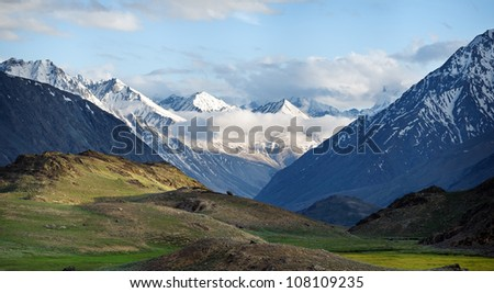 Great View on snowy tops and green valley in summer Himalaya mountains. Himachal Pradesh, India.  - stock photo