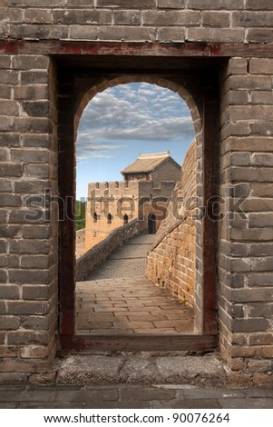 Great Wall in China seen through a watch tower gate the afternoon sunlight - stock photo