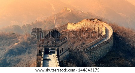 Great Wall in the morning with sunrise and colorful sky in Beijing, China. - stock photo
