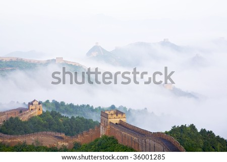great wall of CHINA in fog - stock photo