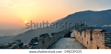 Great Wall sunset panorama over mountains in Beijing, China. - stock photo