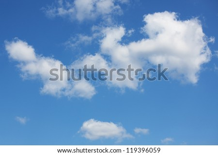 Great white cumulus clouds on a blue clear sky - stock photo
