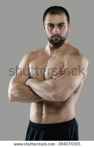 Great workout. Portrait of muscular professional bodybuilder and fitness trainer. Muscular male sportsman is training himself. Gym fitness sport muscle concept. - stock photo