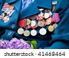 Great World War veteran with medals and lilac - stock photo