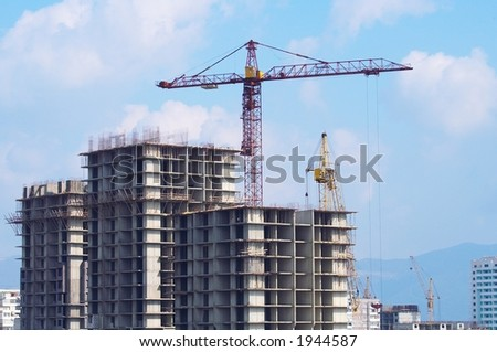 Greater building site with tower cranes - stock photo