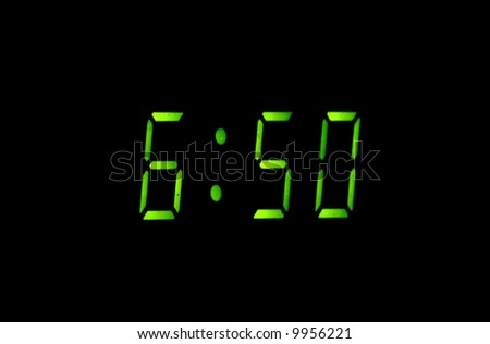 Greater green figures of digital watches on a black background