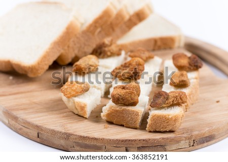 Greaves on the slices toast bread.