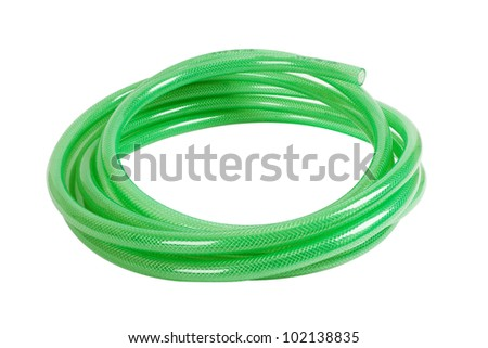gree plastic hose isolated on white background - stock photo