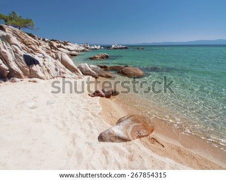 Greece beach, paradise bay untouched nature abstract archipelago in seashore with rocks in water on peninsula Halkidiki, Greece - stock photo