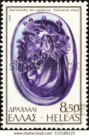 "GREECE - CIRCA 1976: A stamp printed in Greece from the ""Ancient Sealing-stones "" issue shows Head of Silenus, sardonyx, Hellenistic period, circa 1976.  - stock photo"