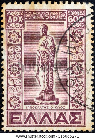 "GREECE - CIRCA 1947: A stamp printed in Greece, from the ''Dodecanese integration"" issue shows statue of Hippocrates, circa 1947. - stock photo"