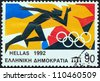 "GREECE - CIRCA 1992: A stamp printed in Greece from the ""Olympic Games, Barcelona"" issue shows a runner, circa 1992. - stock photo"