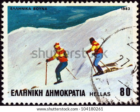 """GREECE - CIRCA 1983: A stamp printed in Greece from the """"Sports"""" issue shows skiers, circa 1983. - stock photo"""