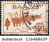 "GREECE - CIRCA 1946: A stamp printed in Greece from the ""Victory. War Scenes"" issue shows Greek infantry column marching in Albania, circa 1946. - stock photo"