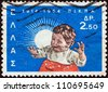 GREECE - CIRCA 1964: A stamp printed in Greece issued for the 50th anniversary of National Institution of Social Welfare (P.I.K.P.A.) shows a child, circa 1964. - stock photo
