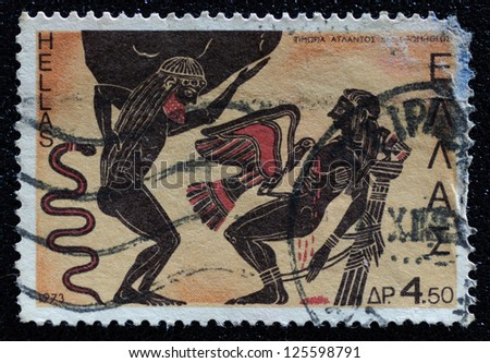 GREECE - CIRCA 1973: A stamp printed in Greece shows Atlas and Prometheus punished by Zeus, circa 1973. - stock photo