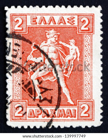 GREECE - CIRCA 1919: a stamp printed in the Greece shows Hermes Carrying Infant Arcas, Design from Greek Coin, circa 1919 - stock photo