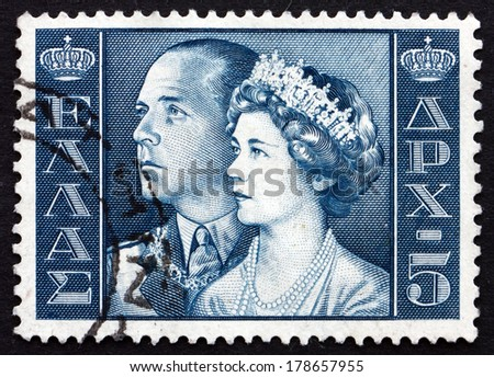 GREECE - CIRCA 1956: a stamp printed in the Greece shows King Paul and Queen Frederica, King and Queen of Greece - stock photo