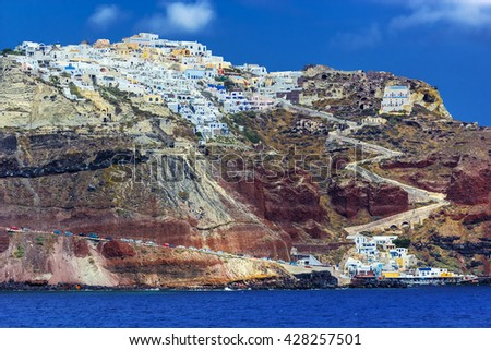 Greece. Cyclades Islands - Santorini (Thira). Oia town with characteristic painted blue cupolas and white walls of houses - stock photo