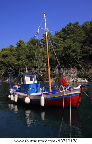 Greece Greek Isles Paxos Gaios Colorful traditional fishing boat in the old harbour - stock photo