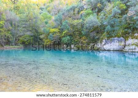 Greece, Ioannina lake river among forest trees - stock photo