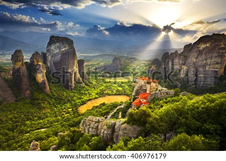 Greece. Meteora - incredible sandstone rock formations. The Holly Monastery of Rousanou and St. Nikolaos Anapafsas Monastery in background. The Meteora area is on UNESCO World Heritage List since 1988 - stock photo